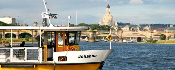 "Photo of the ""Johanna"" Elbe ferry with the cityscape in the background"