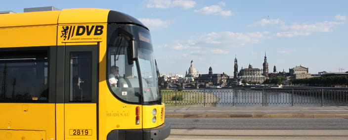Photo of a tram in front of Dresden cityscape