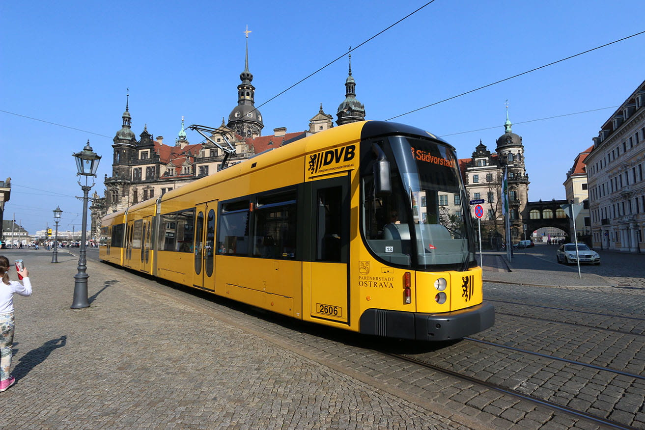 Photo of yellow tram in front of Dresden Palace