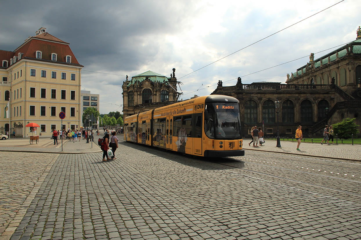 Yellow tram, the Zwinger and Taschenbergpalais in the background