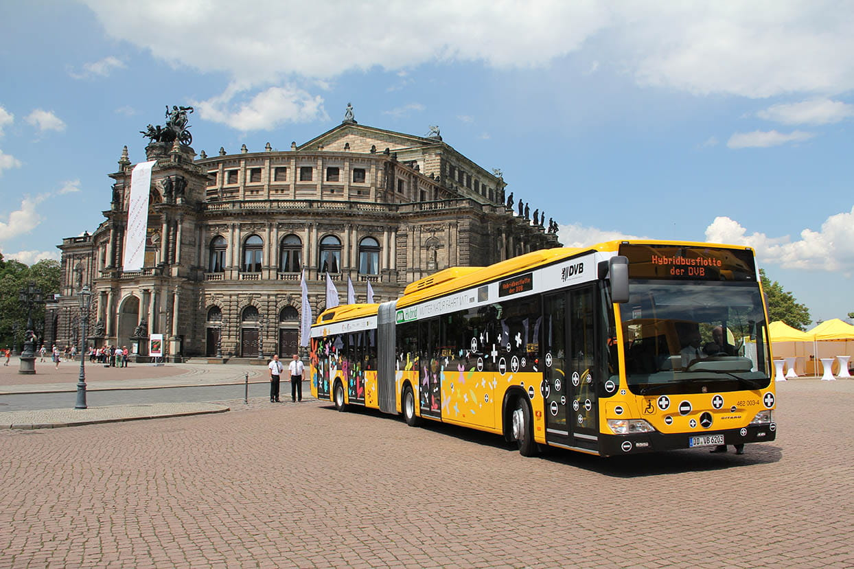Bus in front of Theaterplatz square and the Semper Opera House