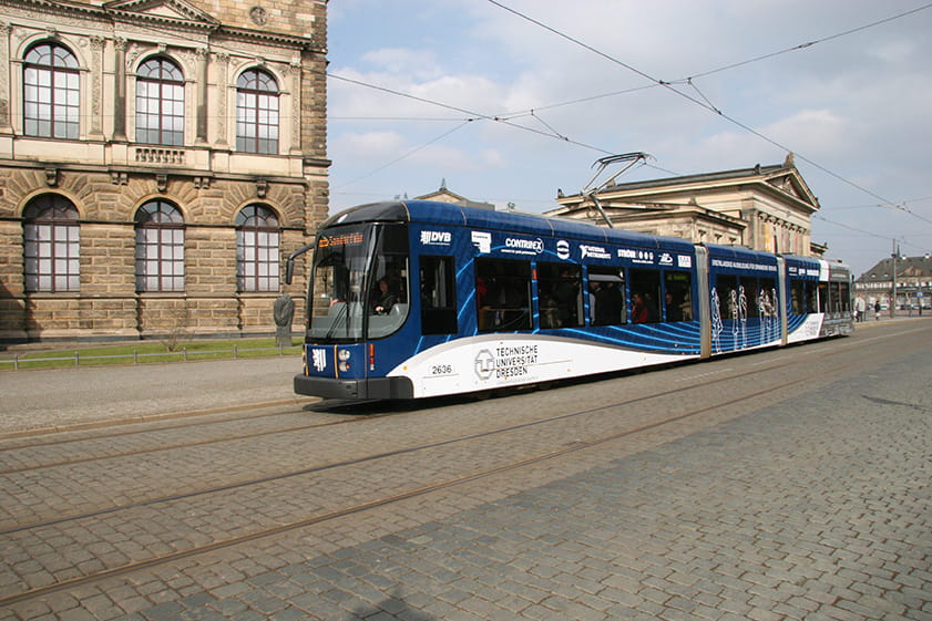 Blue-and-white tram in front of the Zwinger