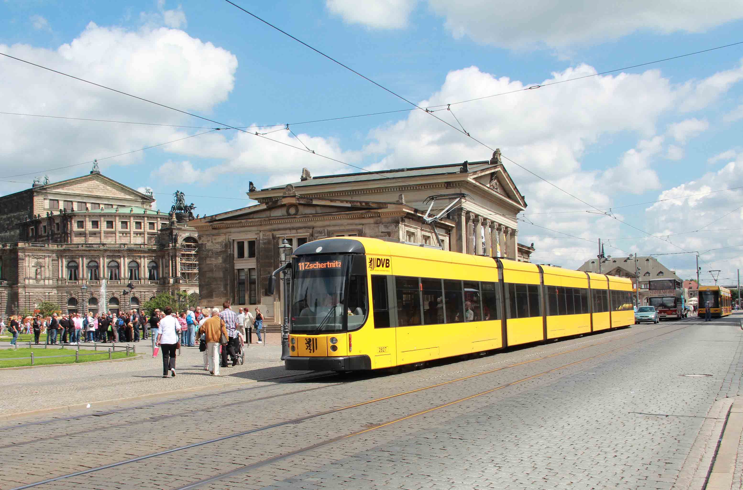 Yellow tram in front of Semper Opera House and Altstädter Wache
