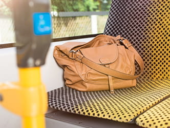 Photo of a bag left behind on the seat of a tram