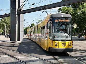 "The photo shows a yellow tram arriving with the words ""special-event trip"" on the display"