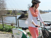 Photo of a woman cycling on an SZbike